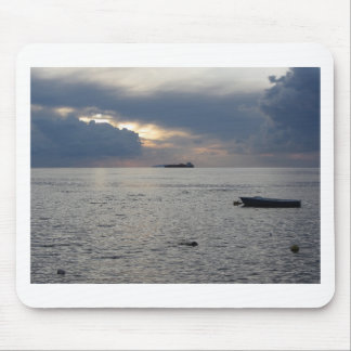 Warm sea sunset with cargo ship at the horizon mouse pad