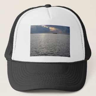 Warm sea sunset with cargo ship at the horizon trucker hat