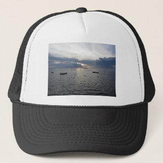 Warm sea sunset with cargo ships trucker hat