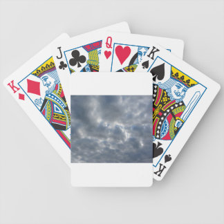 Warm sky with giants cumulonimbus clouds at sunset bicycle playing cards