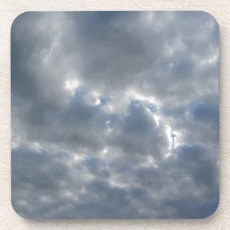 Warm sky with giants cumulonimbus clouds at sunset coaster