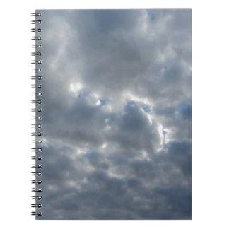 Warm sky with giants cumulonimbus clouds at sunset notebook