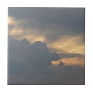 Warm sky with giants cumulonimbus clouds at sunset small square tile