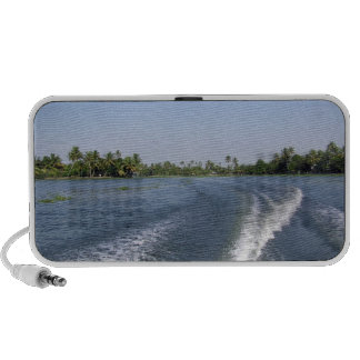 Wash from a boat in a saltwater lagoon mini speakers