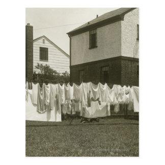 Washing line outside houses postcard