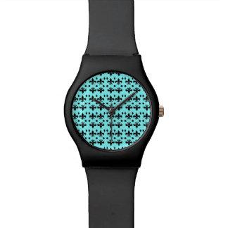 Watch with 'fleur de lis' design