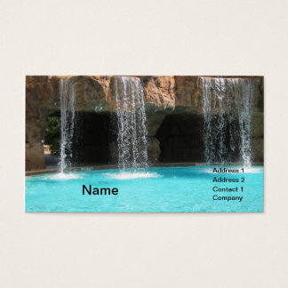 wate cascading by an outdoor cave and pool business card