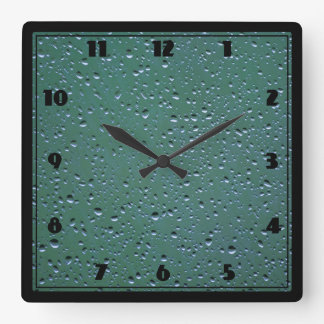 Water Droplets on a Green Background Square Wall Clocks