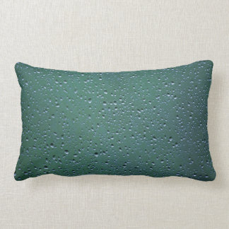 Water Droplets on a Green Background Throw Pillows