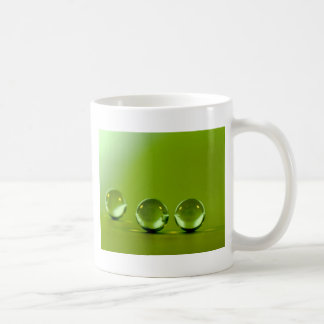 Water droplets on green leaf fresh background mugs