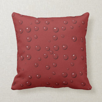 Water drops on amaranth red sand cushion