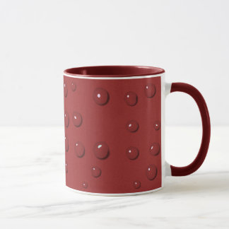 Water drops on amaranth red sand mug