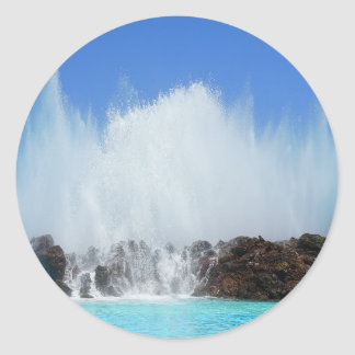 Water hitting rocks on canary islands classic round sticker