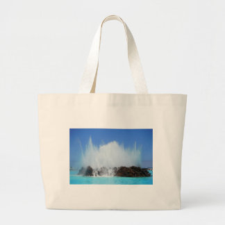 Water hitting rocks on canary islands large tote bag