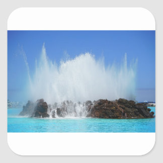 Water hitting rocks on canary islands square sticker