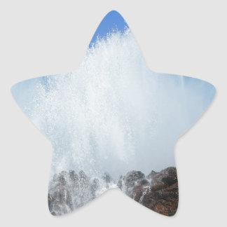 Water hitting rocks on canary islands star sticker