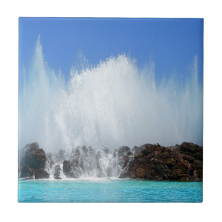 Water hitting rocks on canary islands tile