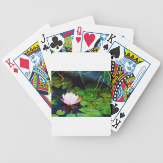 Water lily floating in a pond bicycle playing cards
