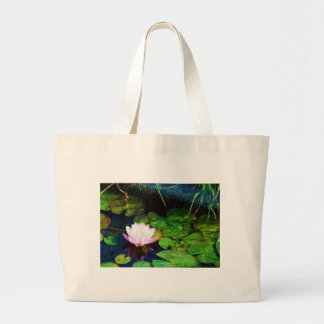 Water lily floating in a pond large tote bag
