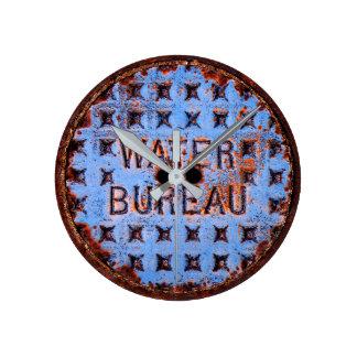 Water Manhole Cover. Rustic. California Round Clock