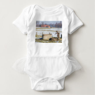 Water pump and well in winter snow landscape baby bodysuit