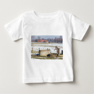 Water pump and well in winter snow landscape baby T-Shirt