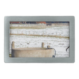 Water pump and well in winter snow landscape belt buckle