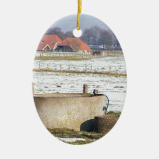 Water pump and well in winter snow landscape ceramic ornament