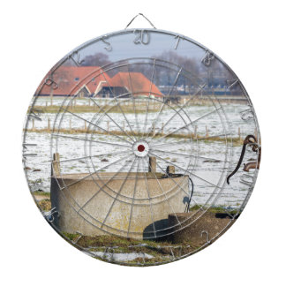 Water pump and well in winter snow landscape dartboard