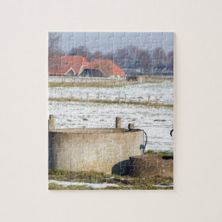 Water pump and well in winter snow landscape jigsaw puzzle