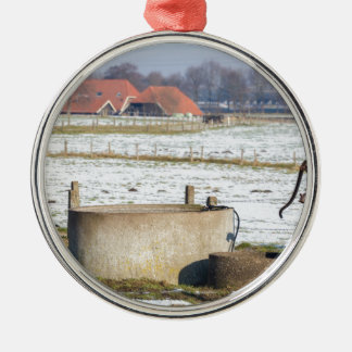 Water pump and well in winter snow landscape metal ornament