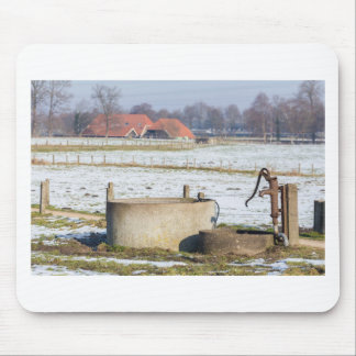 Water pump and well in winter snow landscape mouse pad