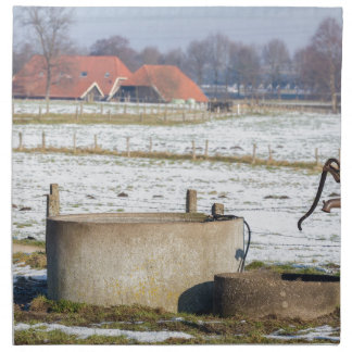 Water pump and well in winter snow landscape napkin
