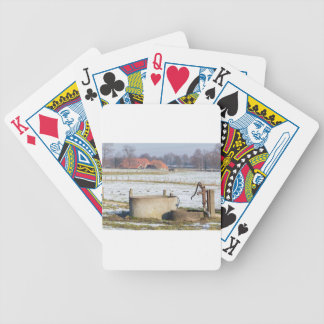 Water pump and well in winter snow landscape poker deck