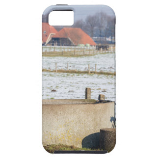 Water pump and well in winter snow landscape tough iPhone 5 case