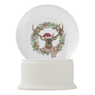 Watercolor holiday wreath with deer head snow globes