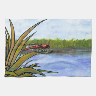 watercolor red dragonfly sitting on grass and lake tea towel