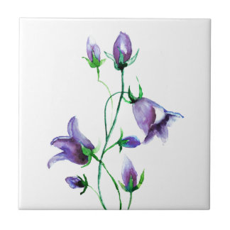 Watercolored violet bluebells on white tile