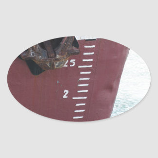 Waterline marked on the ship with scale numbering oval sticker