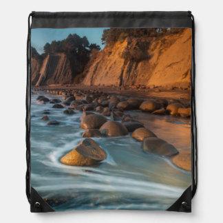 Wave along the beach, California Drawstring Bags