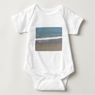 Wave of the sea on the sand beach baby bodysuit