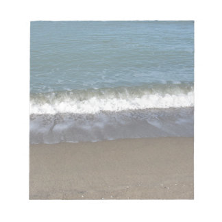 Wave of the sea on the sand beach notepad