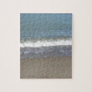 Wave of the sea on the sand beach puzzles