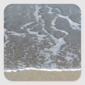 Wave of the sea on the sand beach square sticker