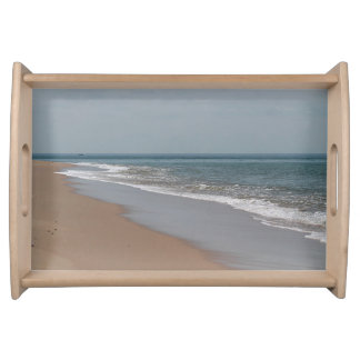 Waves and sandy beach serving tray