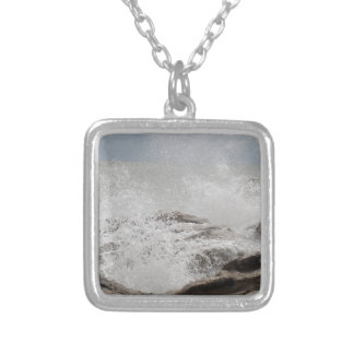 Waves breaking on rocks silver plated necklace