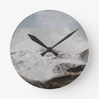 Waves breaking on rocks wall clocks