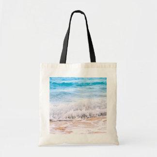 Waves breaking on tropical shore bags