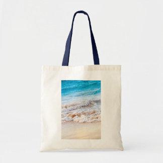 Waves breaking on tropical shore tote bag