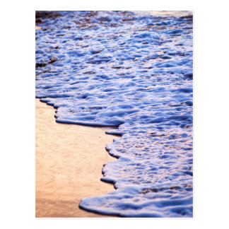 Waves breaking on tropical shore postcard